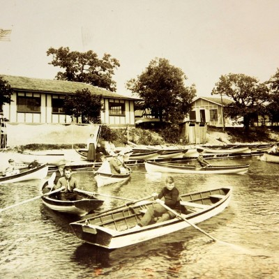 Wooden row boats in front of the Lobby and Pavilion