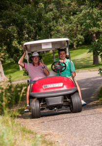 Golfers take a ride in a golf cart at Wildflower Golf Course at Fair Hills Resort. // Photo courtesy of Lauren McMartin, general manager at Wildflower Golf Course at Fair Hills Resort