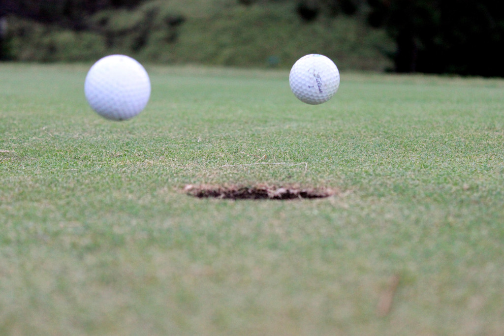 Titelist 1 golf balls are suspended mid-air on hole five of the Fair Hills golf course one morning after Rich Propst pulled the pin. [1 August 2010] // Photo by Tanzi Propst